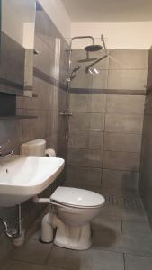 Ein Badezimmer in der Unterkunft HOLI DAY SPA Appartement