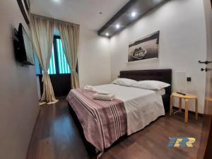 Voodi või voodid majutusasutuse Il Fortino Flats toas