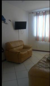 Een zitgedeelte bij Apartamento Cabo Frio
