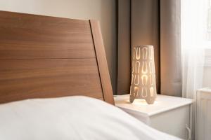 En eller flere senge i et værelse på Na Zborenci Design Apartments
