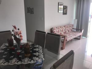 A seating area at Apartamento Praia Dos Milionários