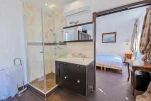 A bathroom at AU BEAU RIVAGE AP2049 by RIVIERA HOLIDAY HOMES