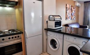 A kitchen or kitchenette at WeStay Apartments-Timessquare