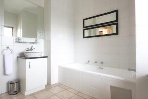 A bathroom at WeStay Apartments-Timessquare