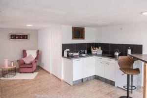 Küche/Küchenzeile in der Unterkunft Wendelstein Lodge