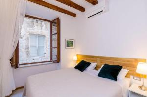 A bed or beds in a room at Zelenci Apartments
