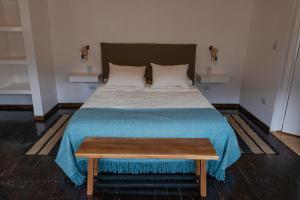 A bed or beds in a room at Complejo Odella Casas de Montaña
