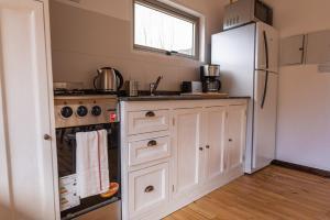 A kitchen or kitchenette at Complejo Odella Casas de Montaña