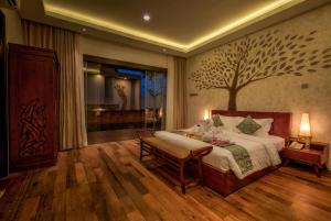 A bed or beds in a room at The Miracle Villa Nusa Dua