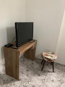 Televisi dan/atau pusat hiburan di Apartamento
