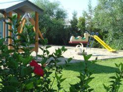 A garden outside Nicki Holiday Resort