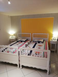 A bed or beds in a room at gîte vacances