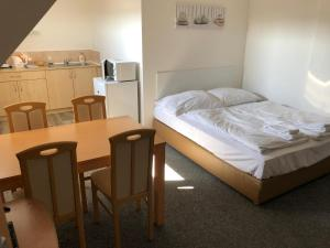 Lova arba lovos apgyvendinimo įstaigoje Apartment Pulse Fitness