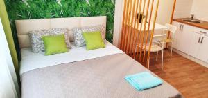 Кровать или кровати в номере Studia Business Class
