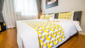 A bed or beds in a room at TOV Hotel & Residence
