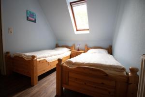 Ein Bett oder Betten in einem Zimmer der Unterkunft Ferienbauernhof Mau