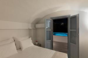 A bed or beds in a room at BlackStone Luxury Suites