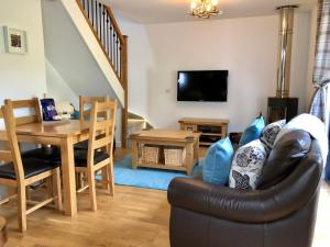 A seating area at Bluebell Cottage with Hot Tub