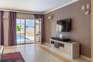 A television and/or entertainment center at Villa Caracos