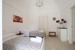 Letto o letti in una camera di Villa Rosato