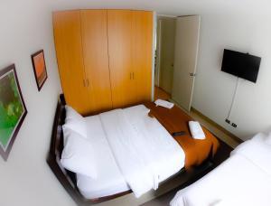 Cama ou camas em um quarto em Panoramic View Exclusive Apartment in Miraflores