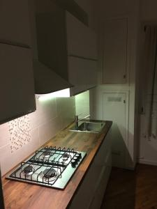 A kitchen or kitchenette at New Capolinea 5 - Apartment