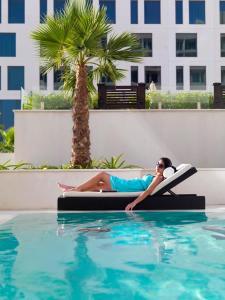 The swimming pool at or near Staybridge Suites Yas Island Abu Dhabi