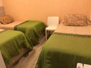 A bed or beds in a room at Giova Apart Salta