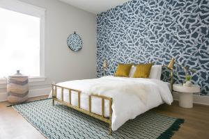 A bed or beds in a room at Sonder — The William Penn