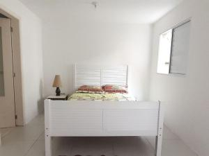 A bed or beds in a room at DELETAR Galeria