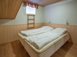 A bed or beds in a room at Holiday Home Yllästar 1 as 209 (la-la)
