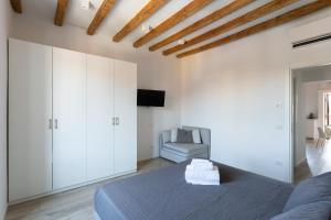 A television and/or entertainment center at Milano Apartments Vigevano
