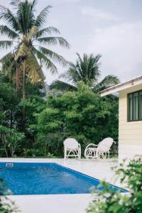 Der Swimmingpool an oder in der Nähe von Villa Tiga (v3) @ Datai Valley