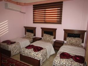 A bed or beds in a room at Juniper House