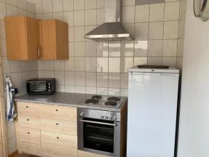 A kitchen or kitchenette at Ferienwohnung München-Perlach