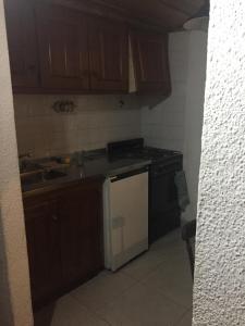 Una cocina o kitchenette en Apartamento en Hosteria del Cerro