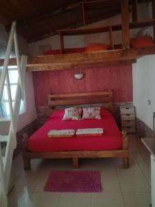 A bed or beds in a room at Casa Vacanze Primavera
