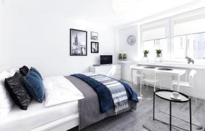 Łóżko lub łóżka w pokoju w obiekcie Warsawrent Apartamenty Centralna