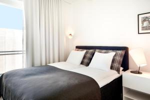 Lova arba lovos apgyvendinimo įstaigoje Apartment Hotel Aallonkoti