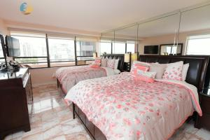 A bed or beds in a room at MA3201 Beachfront Luxury 3 bed 2 bath Miami Beach Condo