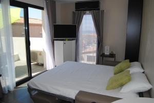 Ein Bett oder Betten in einem Zimmer der Unterkunft Appart'hôtel Le Dauphin