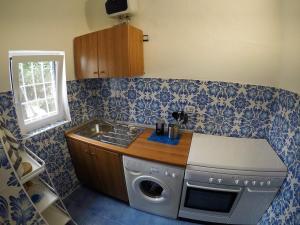 A kitchen or kitchenette at Villa La Mura