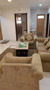 A seating area at النايفة للوحدات السكنية المفروشة