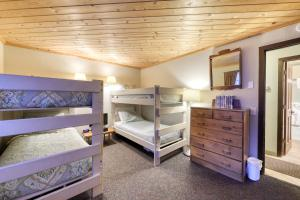 A bunk bed or bunk beds in a room at Chateau Sans Nom 19