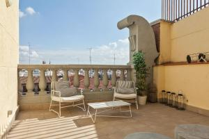 A balcony or terrace at Canaan Boutique Apartments Madrid