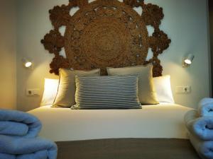A bed or beds in a room at El Balcón de Torre Nueva III