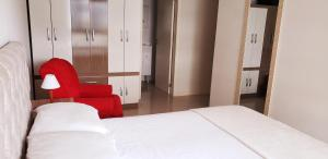 A bed or beds in a room at Residencial Encantos do Mar