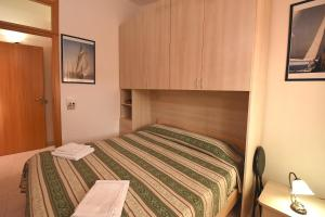 A bed or beds in a room at Residenza Le Due Palme