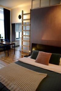 Een bed of bedden in een kamer bij Morpheus