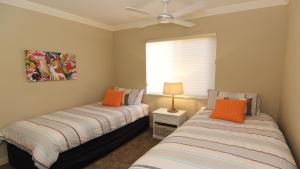 A bed or beds in a room at Whitesands 301 - Main Beach Location